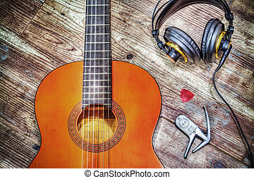 classic guitar and headphones in hdr - classic guitar and...