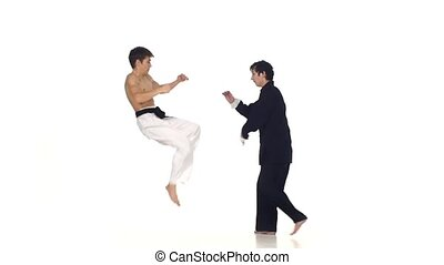 Sparrynh taekwondo and wushu or karate man, blows from each...