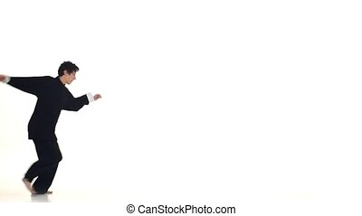 young wushu makes rack on a white background, Slow motion -...