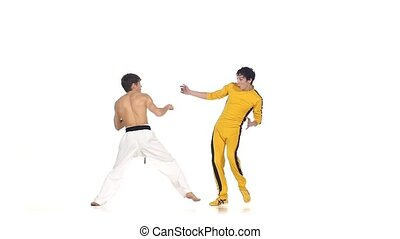 karate and taekwondo sparring: strikes . Slow motion, One of...
