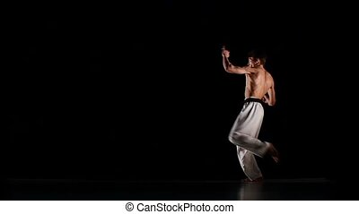 Man training taekwondo or karate man jumping,  Slow motion