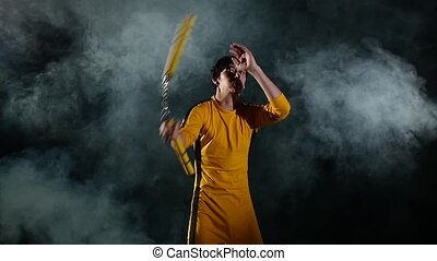 exercise with nunchaku, from the young karate. Slow motion -...
