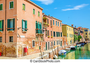 Canal with boats and buldings, Venice, Italy - Scenic canal...