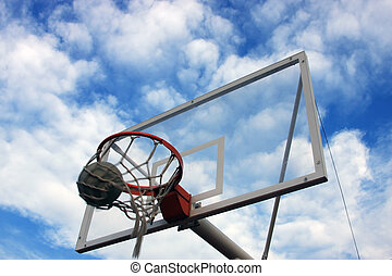 Basketball Hoop - Basketball hoop with cloudy sky