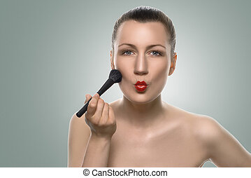 Woman Putting Makeup on Face with Pouting Lips - Close up...
