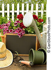 gardening tools,flowers,straw hat and a little chalkboard...