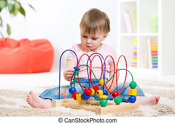 kid plays with educational toy indoor