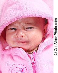 Baby - Beuty baby crying with pink hood Portrait