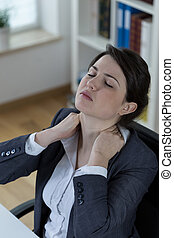Tiredness at work - Tired women with neck ache at work