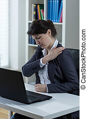 Overwork in the office - Overworked women feels arm pain in...