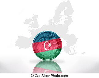 euro coin with azerbaijani flag on the european union map background
