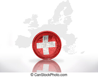 euro coin with swiss flag on the european union map...