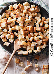 Homemade croutons vertical view above, rustic - Homemade...