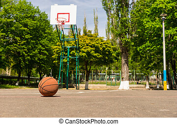 Basketball on Empty Basketball Court