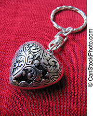 Heart Keyring - An ornate, heart shaped keyring on red...