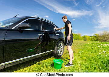 Man Washing Car in Field on Sunny Day - Full Length of Man...
