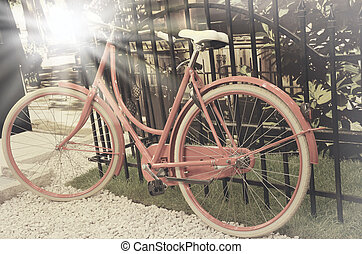 vintage photo of red bicycle parked in the front of the...