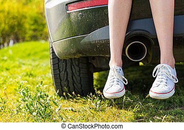 Woman Wearing Sneakers Sitting on Tailgate of Car - Close Up...
