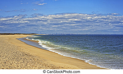 Ocean shore and view to NYC from Sandy Hook, NJ at windy...