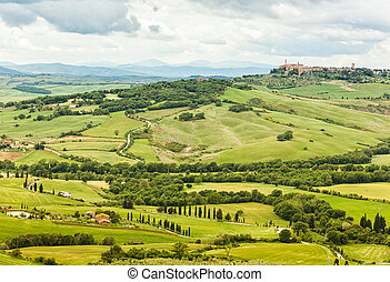 View of the town of Pienza with the typical Tuscan hills...