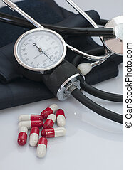Pills, stethosco and sphygmomanomet - Pills to control and...