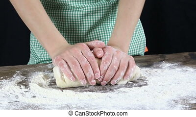 Girl mixing the dough - Girls hands mixing the dough on...