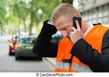 Man Calling On Cellphone After Car Accident - Young Male...