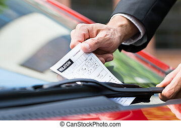 Parking Ticket On Car's Windshield - Close-up Of A Man...