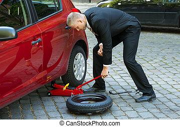 Man Using Red Hydraulic Floor Jack For Car Repairing - Man...