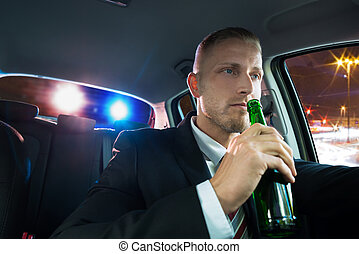 Man Drinking Beer Pulled Over By Police - Young Man Drinking...