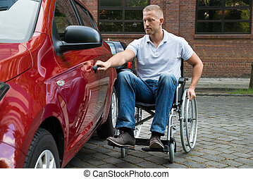 Handicapped Man Opening Door Of A Car - Portrait Of A...
