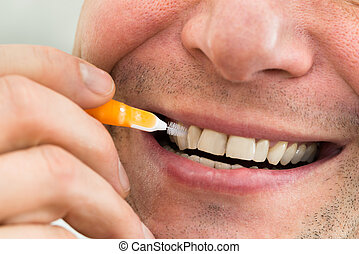 Man Cleaning His Teeth - Close-up Of A Man Cleaning His...