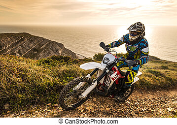 Enduro bike rider - Enduro rider climbing a steep slope...