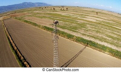 Aerial view at a stork nest on the high voltage transmission...