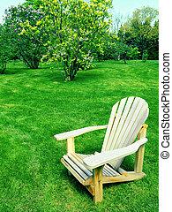 Wooden chair in spring garden