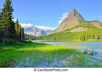 Swiftcurrent lake in high alpine landscape on the Grinnell...
