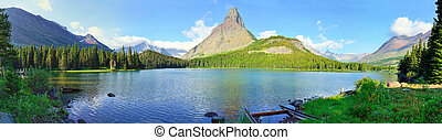 panoramic view of the Swiftcurrent lake in high alpine...