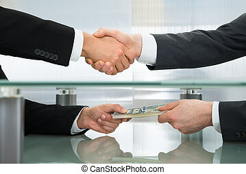 Businessman Accepting An Offer Of Money - Close-up Of...