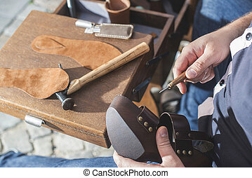 Hands making shoes Shoemaker