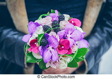 bridal bouquet in hands of the groom, of close-up - bridal...