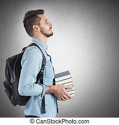 Student studying to achieve objectives - Confident student...