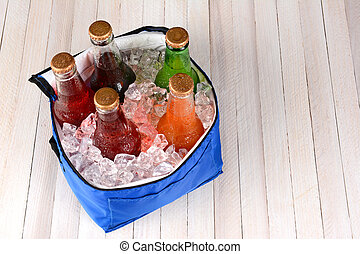 Cooler With Ice and Soda Bottles - High angle shot of a...