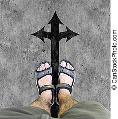 Black sandals on the road A man standing on the road the...