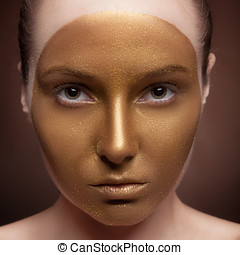 Woman with artistic make up on face on brown background Art...