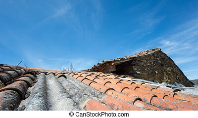 Clouds over tile roof, Time Lapse in 4K - Sliding camera...
