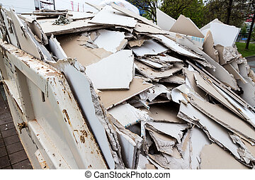 rubble plasterboard in container - in a waste container...