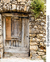 old door made of wood - old wooden door in an old stone...