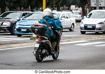 scooter in the city - scooter on the city road with helmet4