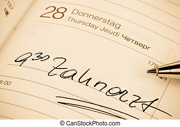 entry in the calendar: dentist - an appointment is entered...