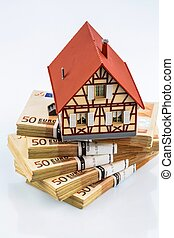 half-timbered house on euro banknotes, symbol photo for home...